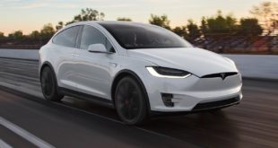 Model X Beats Supercar In A Drag Race, While Also Towing A Copy Of The Same Supercar