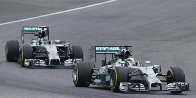 Mercedes drivers Lewis Hamilton of Britain, right, and Nico Rosberg of Germany steer their cars during the first training session at the race track  in Spielberg,  Austria,  Friday, June 20, 2014. The Austrian Formula One Grand Prix will be held on Sunday. (AP Photo/Darko Bandic)
