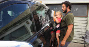 Genius Used His Baby To Wash His Car. It's Adorably Questionable